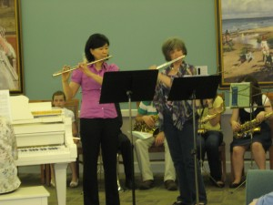 A mother plays a duet with our founder